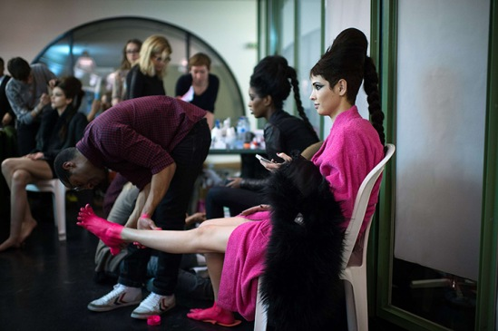 Paris, France: A model gets her feet painted backstage